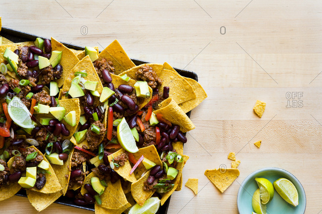 A platter of nachos for a party