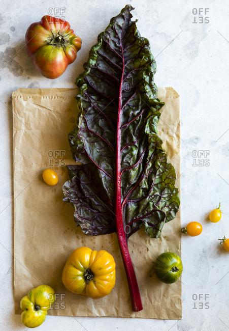 Tomato swiss chard leaf on paper bag