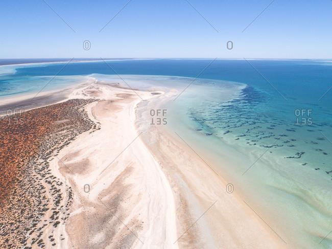 Aerial view along sand peninsula and turquoise seas of Shark Bay, Australia