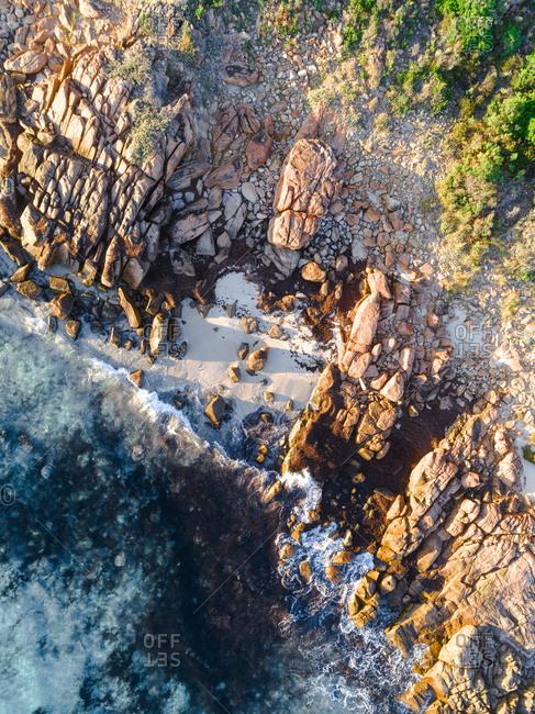 Aerial view of low sun lighting rocky coast of Albany, Australia