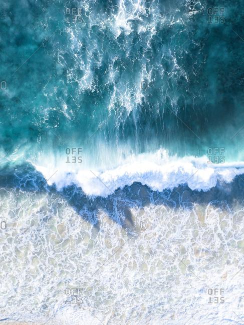 Looking down on wave breaking on coast of Esperance, Australia