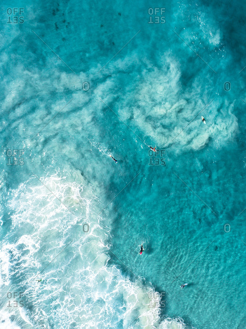 Aerial view of surfers paddling in turquoise waters of Esperance, Australia