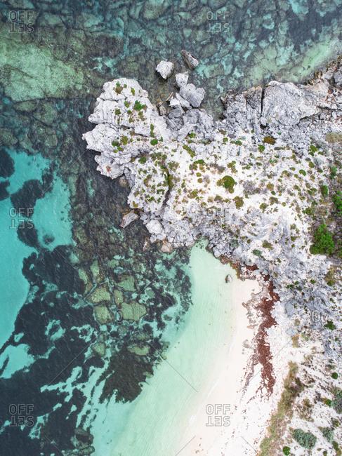 Aerial view of rocky headland and sea off Rottnest Island, Australia