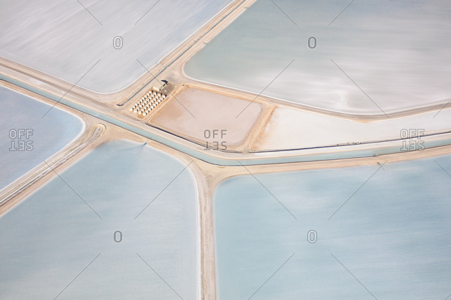 Aerial view of storage structure surrounded by milky salt fields in Shark Bay, Australia