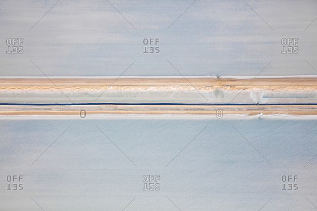 Looking down on salt fields bisected by access road in Shark Bay, Australia
