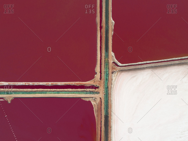 Looking down on intersection of access roads in vivid red salt fields of Western Australia