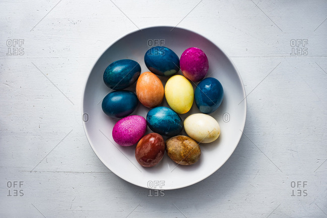 Colorful naturally died Easter eggs in a dish