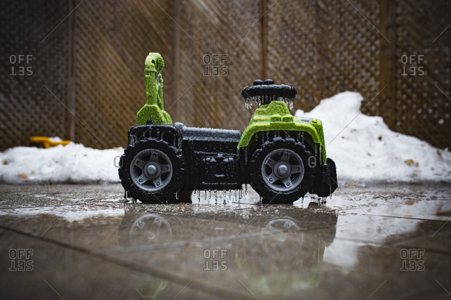 Child's ride-on toy covered in ice