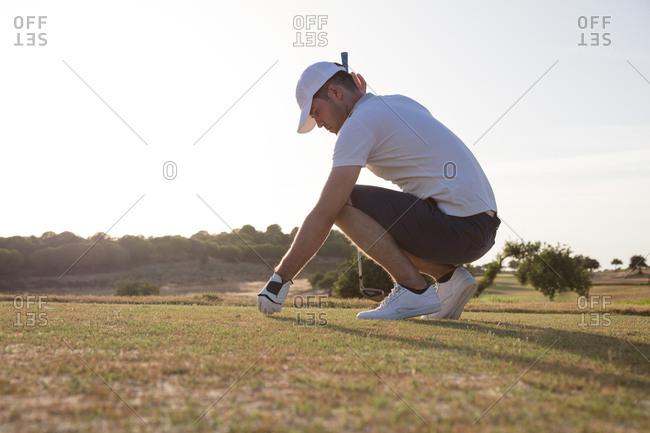 Golfer preparing for tee off