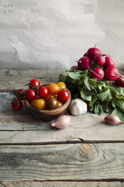Heap of fresh raw vegetables on wooden background. ingredients concept