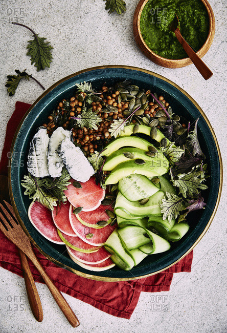 Healthy salad: watermelon radish, ash coated goat cheese, avocado, baby kale