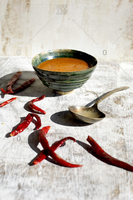 Bowl of hot sauce with arbol chili peppers