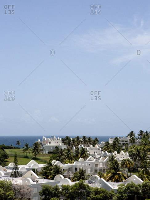White buildings on oceanfront resort property in the summer, Puerto Rico