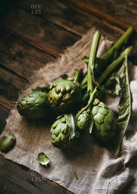 Bundle of raw artichokes on a cloth