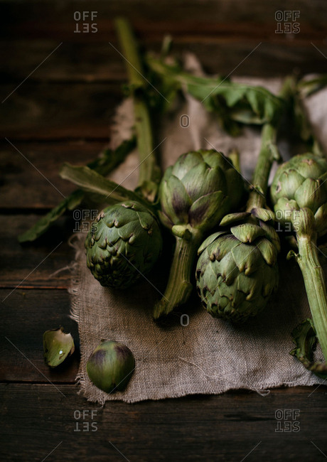 Raw artichokes on a cloth