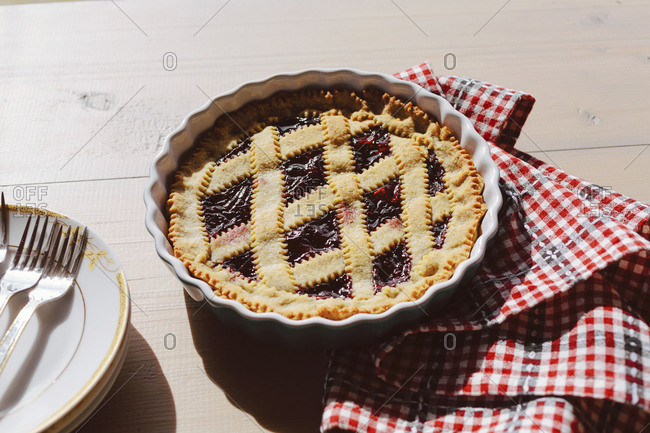 Italian crostata pie with jam on wooden table outdoor