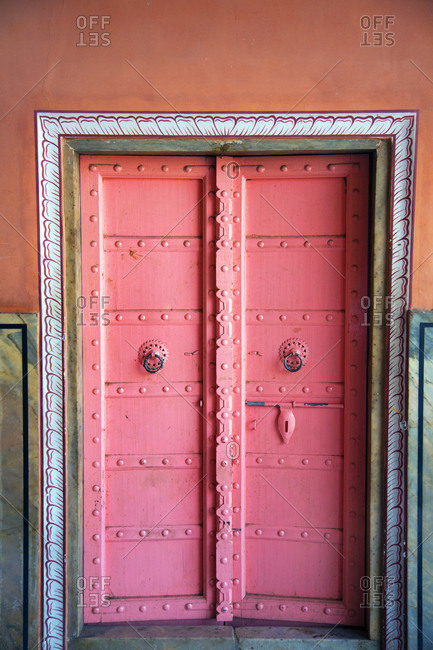 Bright pink door in Pink City of Jaipur, India