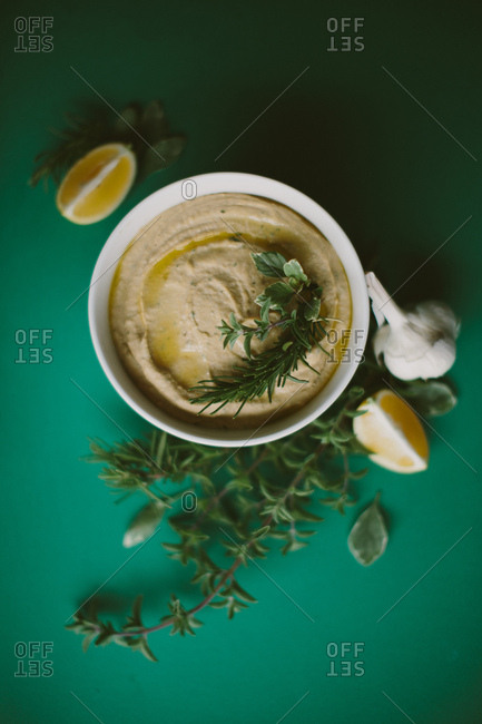 Hummus with herbs and fresh ingredients from above