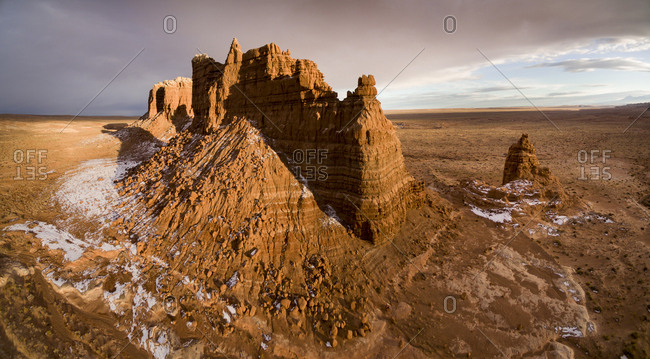 USA, Utah, Green River, Goblin Valley State Park, Aerial view of Molly's Castle rock formation at sunset on winter evening
