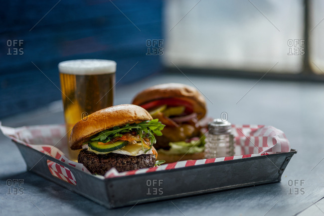 Close up of burgers served with beer