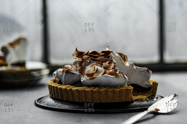 Chocolate meringue pie being served