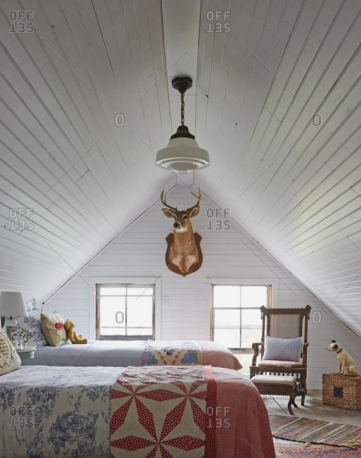 Callicoon, New York - July 30, 2015: Farmhouse attic bedroom