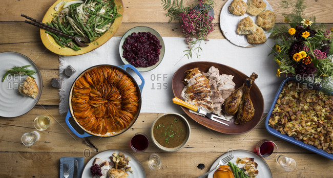 Traditional family Thanksgiving dinner served on wood table from above