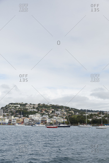Fort de France, Martinique - January 10, 2016: View across water of boats leaving Fort de France