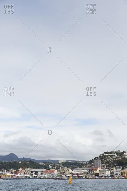 Fort de France, Martinique - January 10, 2016: Distant view of overcast Fort de France from Martinique ferry