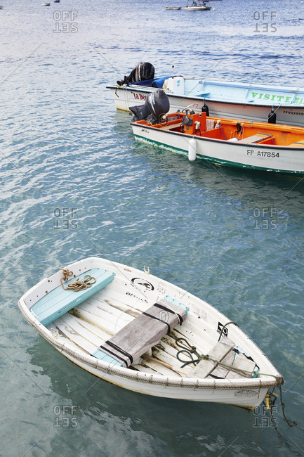 Anse a l'Ane, Martinique - January 11, 2016: Three parked boats on water