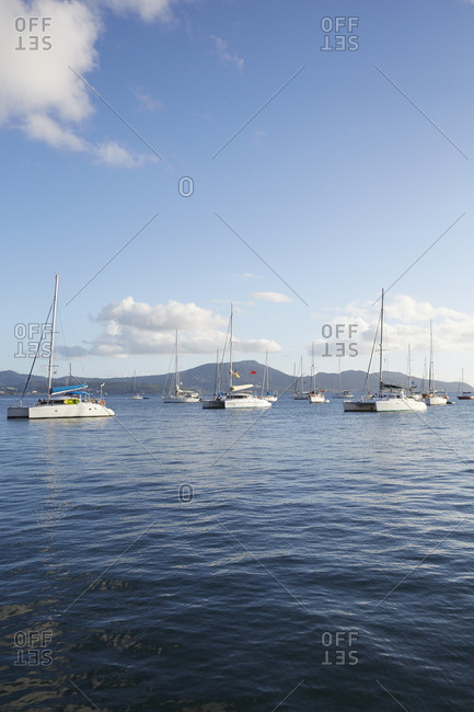Fort de France, Martinique - January 11, 2016: Boats on water in front of mountain range