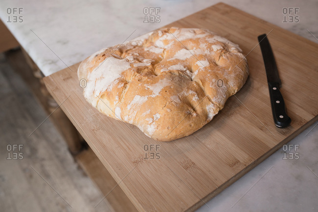 Fresh baked loaf of bread on a cutting board