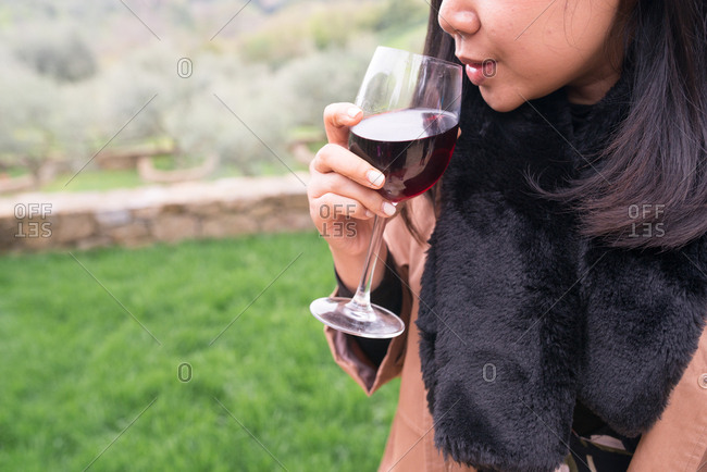 Close up of woman drinking wine in Tuscany, Italy