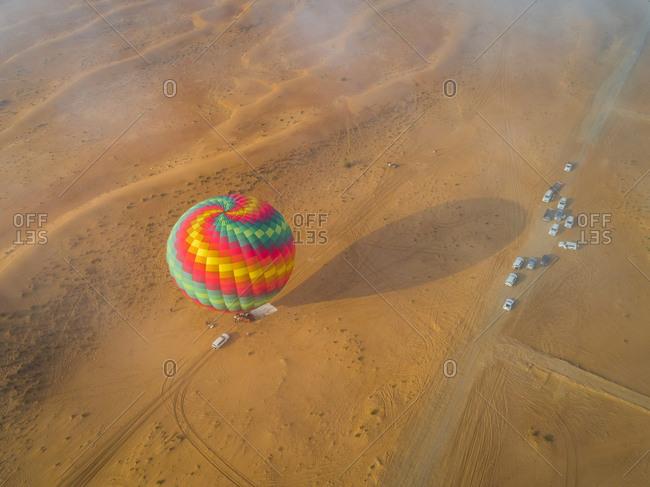 Aerial view of an hot-air-balloon landing in the Murqquab desert in Dubai, U.A.E.