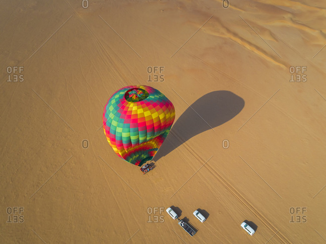 Aerial view of an hot-air-balloon landing in the Murqquab desert in Dubai, U.A.E.