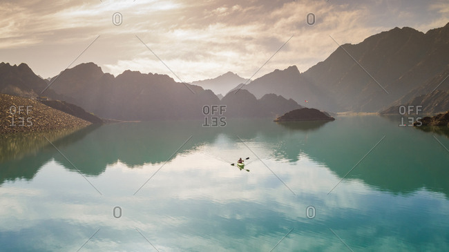 Aerial view of a kayaker on Hatta lake in Dubai, U.A.E.