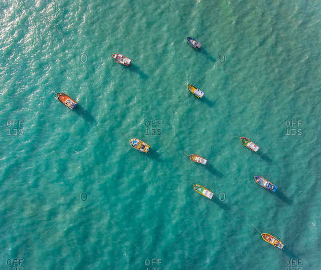 Aerial view of traditional fishing boat moored in the turquoise sea of Rio do Fogo, Brazil.