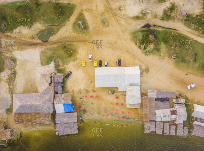 Aerial view of small cabins in Caiupe Lagoon area in Brazil.