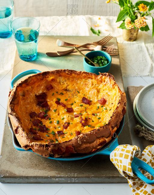 Looking down on Country Ham and Cheddar Dutch Baby served in cast iron skillet