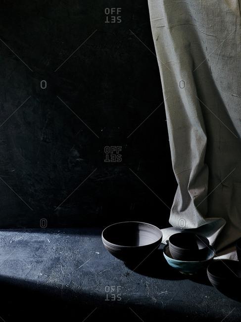 High angle view of ray of sunshine lighting handmade ceramic bowls