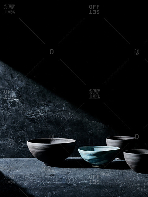 Handmade ceramic bowls against black backdrop