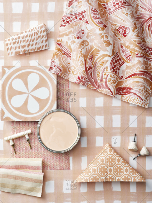 Top down view of fabrics and fixtures of different shades of pink