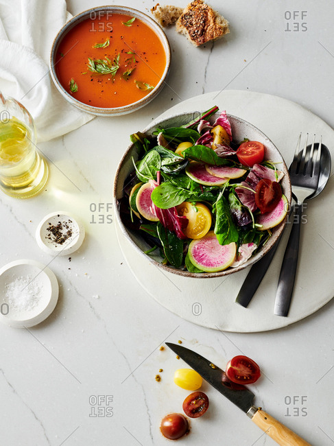 Salad of watermelon radishes, pea shoots, tomatoes and lettuce served with blood orange vinaigrette and carrot soup