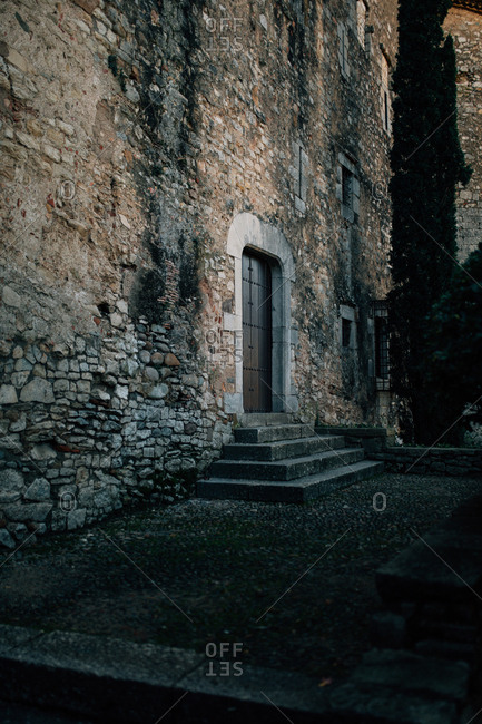 Shadowy angled view of old stone building doorway