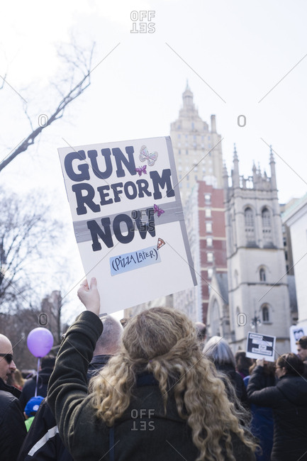New York, NY - March 24, 2018: Woman holding gun control sign at political rally
