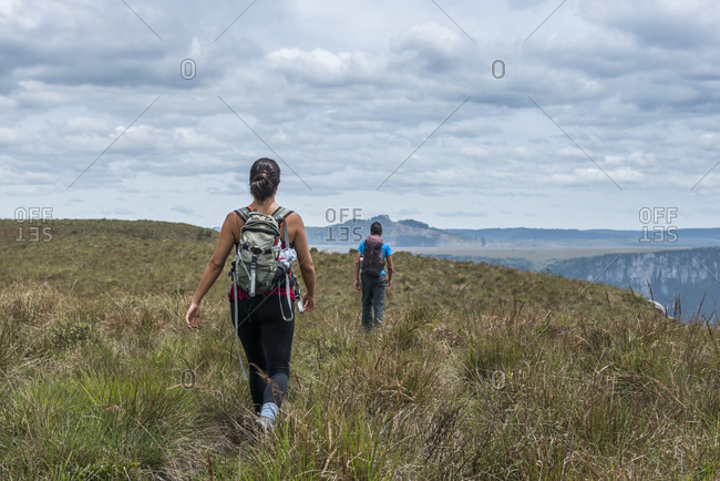 Man and woman hiking in Canion Fortaleza, Cambara do Sul, Rio Grande do Sul, Brazil