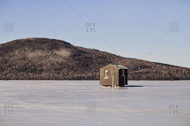 An ice fishing shack stands on a frozen lake near Jackman, Maine.
