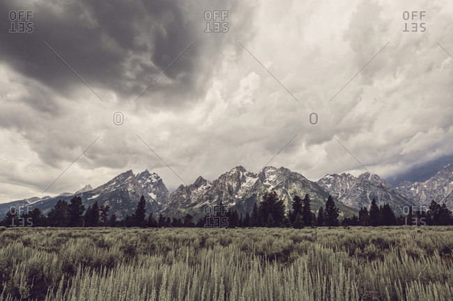 A summer thunder storm passes over the Tetons near Jackson Hole and Grand Teton National Park, Wyoming