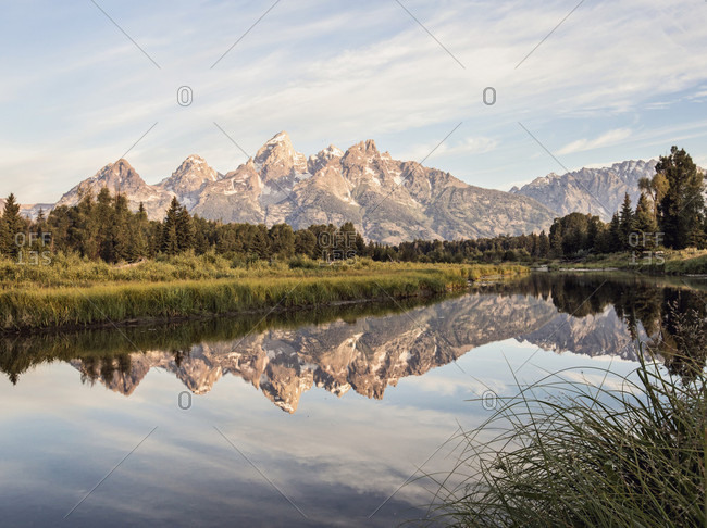 The Tetons are reflected in the Snake River near Jackson Hole, Wyoming.