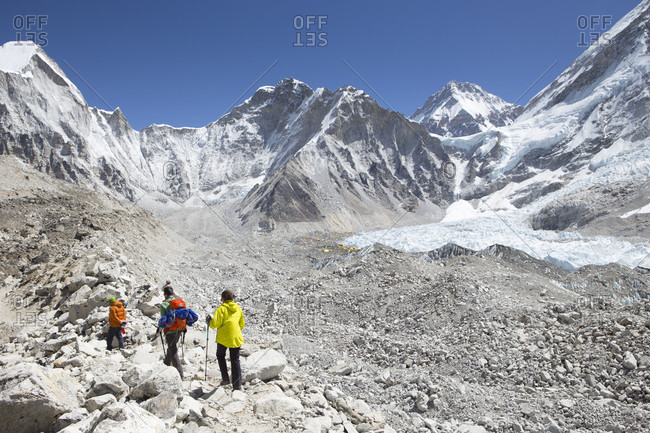 April 18, 2017: Three hikers are arriving in Everest Base Camp after a trekking through the Nepalese Khumbu valley. The trek to Everest Base Camp (EBC) is possibly the most dramatic and picturesque in the Nepalese Himalaya. Not only will you stand face to face with Mount Everest, Sagarmatha in Nepali language, at 8,848 m (29,029 ft), but you will be following in the footsteps of great mountaineers like Edmund Hillary and Tenzing Norgay. The trek is scenic and offers ever-changing Himalayan scenery through forests, hills and quaint villages. A great sense of anticipation builds as you trek up the Khumbu Valley, passing through intriguing Sherpa villages, Tibetan monasteries, all towered over by some of highest and most stunningly beautiful mountains of the world.